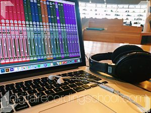 A Latop Running Protools with Headphones laying next to it