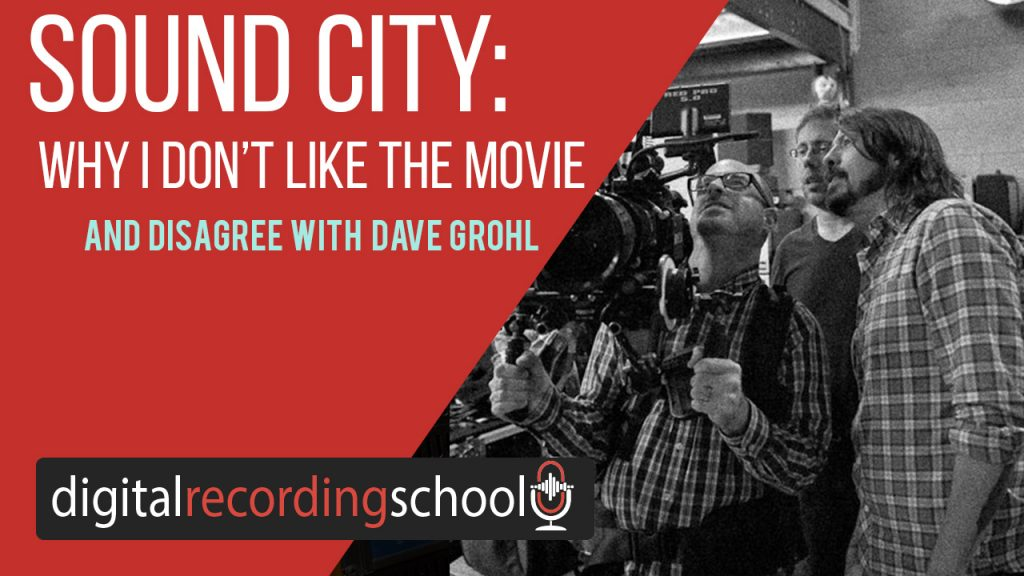 Dave Grohl looking with 2 other people into a large camera during the shoot of Sound City